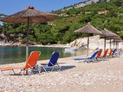 13_Romantic-beach-with-deck-chairs-and-sun-umbrellas,-island-Thassos,-Greece